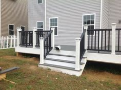 Simple Outdoor Deck with Trex Enhance Clamshell Composite Decking Lowes, and Solar Post Caps Light Deck. Black Deck, White Deck, Black Railing, Outside Stairs, Deck Posts, Balustrades, Deck Decorating, Backyard, Patio