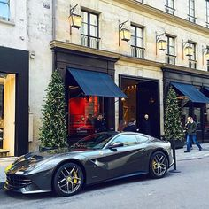 Gray Ferrari in a shopping street, don't be fooled though, it's ready to rev your ears off! F12 Berlinetta, Shopping Street, Cool Bikes, Fast Cars, Dream Cars, Ferrari, Ears, Bmw, Grey