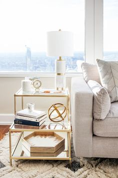 "The <a href=""http://www.westelm.com/products/terrace-side-table-h530/?pkey=ccoffee-side-tables%7Cside-tables"">West Elm Terrace side table</a> is an oldie but goodie! It's the perfect piece to showcase the accessories and trinkets we've collected over the years. Displaying a curated selection of personal items is key to making an apartment feel like home."
