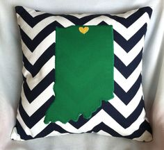 12x12 throw pillow. Hand-stitched heart over South Bend. Applique state of Indiana. Green and navy colors are in tribute to the Notre Dame Fighting