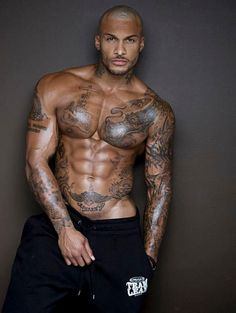 DAYUMMMM, why would he go and ruin such a beautiful canvas of a body with all those tattoos?? Ugggg, and I really dislike it more when a GUY has a belly tattoo. Uggggh David McIntosh