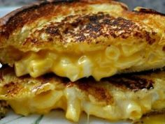 Mac n Cheese Grilled Cheese: Prepare your favorite mac & cheese, refrigerate until firm, cut the mac & cheese to fit in between two slices of bread, top with a slice of cheddar or american, and grill away! Don't forget to butter the bread! Oooey gooey goodness! #GrilledCheeseMonth2014