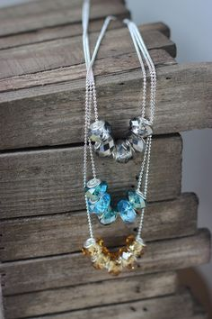 Crystalcut glass beads on a silver plated chain by chunkysquare, $19.00