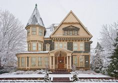beautiful photo of a victorian queen anne house in a winter storm - by Ken Zirkel