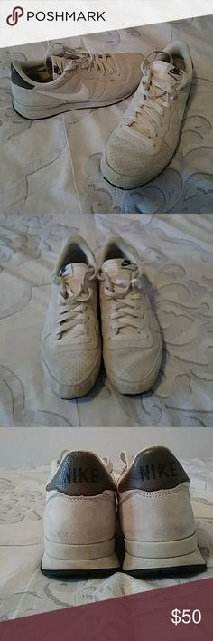 Vintage Nike sneaker Vintage Nike sneaker suede off-white coloring with a white Swoosh only worn a couple times in great condition coloring might throw you off but they're supposed to have that vintage suede look Nike Shoes Sneakers