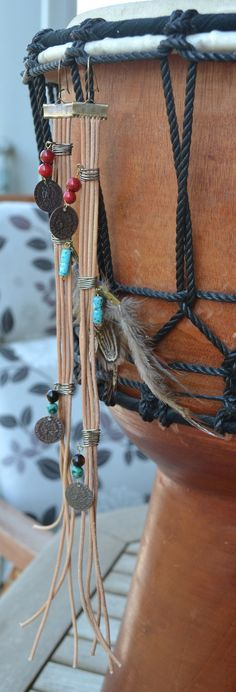Long leather earrings with african turquoise, coral, tiger eye and turquoise beads, bronze wire, coins  and feathers
