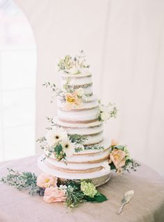 Rustic summer four tier wedding cake: Photography: Natashia Nicole Photography - natashianicolephotography.com Read More on SMP: http://www.stylemepretty.com/2016/08/24/rustic-northwoods-wedding/