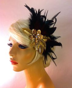 ~Black Hackle feathers~  ~Burgundy Iridescent Coque Feathers~  ~Black Biots~  ~Sequined Rhinestone center piece~  ~Attaches With 2 alligator clips~