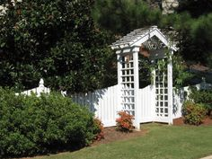 Small arbor and trellis adjoining gate and picket fence. Designed and built by Atlanta Decking & Fence.