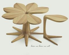 Wood flower shaped table and chairs. Together they form a flower table, but they separate into stools. #clever #pretty