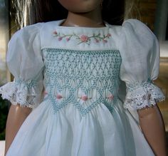 smocked and embroidered doll dress