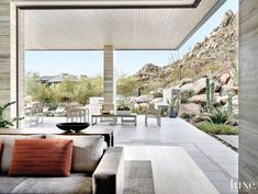 Contemporary Neutral Indoor-Outdoor Space with Motorized Door Panels