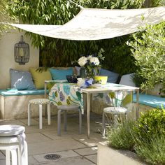 l shape seating with plants behind. Our seating with have hidden storage. Like the canvas tarp for shade.
