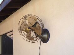 Vintage industrial 1940s GE General Electric oscillating wall mount table Fan