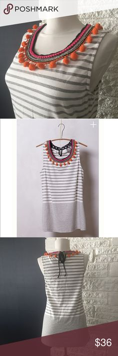 Anthropologie one.september Colorpom Tank Balancing innovative prints with vibrant color, LA-based one.september imbues their easy, go-to shapes with femme fabric manipulation, a vintage feel and a dose of sunny optimism. Case in point: this pompom-adorned tank. Anthropologie Tops