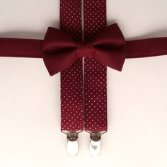 Burgundy suspenders and bow tie. Matching burgundy swiss dot/pin dot bow tie also available upon request. Each superior-quality item from our shop is