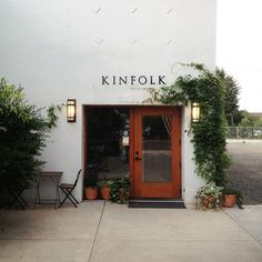 Simple stucco facade with lots of greenery.                                                                                                                                                                                 More