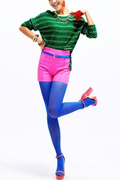 Jumper made of acrylic fiber, featuring round neck, long sleeves, fluorescent striped design with high low hem, all in loose fit.