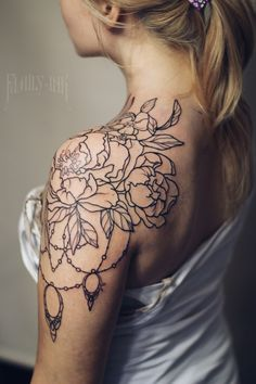 Vintage flowers and lace tattoo by Family Ink. Shoulder tattoo