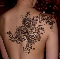 mehndi style - it would be beautiful with white ink incorporated into it.