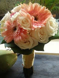 Antique light pink gerberas with white roses - maybe incorporate these flowers into the centerpieces