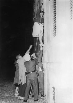 Ideal A woman is lowered from a window in Bernauer Strasse on a rope to escape into the western sector of Berlin after the post war division of the city