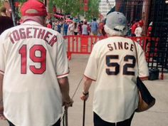 This couple's matching jerseys are the definition of #relationshipgoals