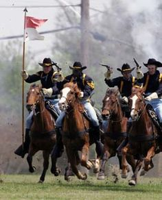 1st Cavalry Division Horse Detachment reenacts a traditional cavalry charge for the retirement ceremony in honor of GEN Leon J. LaPorte, Fort Hood, TX, 31 Mar 2006