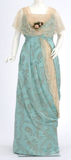 Robin's egg blue brocaded satin gown. Made by dressmaker Elizabeth Elser, Minneapolis, Minnesota. 1910-1919.