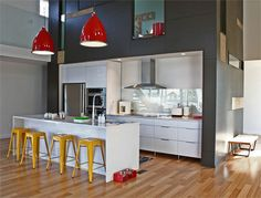grey & white kitchen with pops of bright colour
