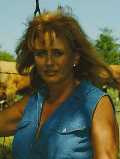 Photo of a younger Anita Waggoner taken on her ranch in Oklahoma 2004. This photo is featured on the cover of the latest edition of Farewell to Freedom.