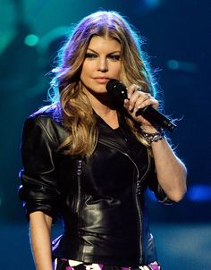 Fergie (of Black Eyed Peas) // aka Stacy Ann Ferguson // Minority owner in the Miami Dolphins, as well as her own shoe, nail polish and perfume lines. Has equity in vodka company, Voli, and due to release her own wine, Ferguson Crest. // Info via forbes.com