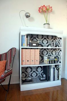 Spruce up old book shelf with fabric or scrapbook paper or wallpaper