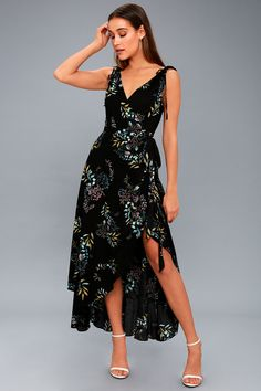 Hot nights on the dance floor call for the Amal Black Floral Print Wrap Maxi Dress! Textured, woven rayon, in a blue, mint, yellow, and purple floral print, falls from tank straps with decorative ties, into a surplice bodice. Fitted waist tops a tying, wrap, maxi skirt (with internal ties) and high-low silhouette. V-back.