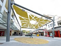 """An artist-designed intervention called """"Echo Orbit"""" is adding shade as well as beauty to Brisbane. Beneath the canopy are local musicians's song lyrics painted onto the sidewalk, reflecting the artistic importance of the site. #LQC #Placemaking"""