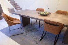 Janey Butler Interiors - stylish leather Kekke Dining Chairs & Gerrit Dining Table at the JB Design Studio