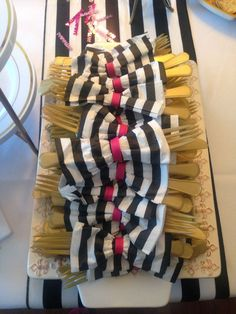 Kate Spade Themed Party -Gold utensils with napkins tied with a pink bow to look like Kate Spade bows! Easy DIY! -