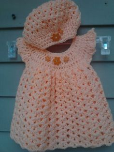 Baby dress and slouchy hat....they are more adorable than I imagined! Peach with orange buttons shaped like flowers.   Oh, did I mention that I made these?!: