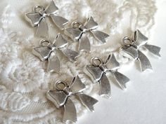 10 Silver Bow Charms Vintage Tied Bow Tie Flat Back by BuyDiy