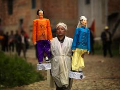 Man with puppets at funerals - Yunnan Province, China