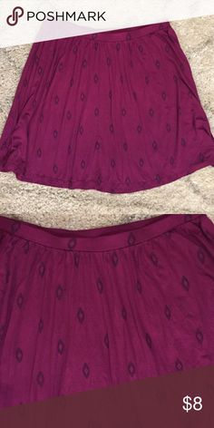 Fun pink and black skirt Size L A fun and flirty elastic waist skirt made of 95% rayon 5% spandex in a magenta pink with black print Old Navy Skirts