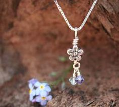 "Forget Me Not Miscarriage Memorial Necklace - a sweet forget me not with a birthstone of your choosing to keep your baby's memory close to your heart. Comes on an 18"" sterling chain.$29.75 #miscarriage #babyloss #jewelry #miscarriagejewelry #memorial #pregnancyloss #gift"