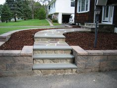 A mix of stone and concrete steps for the hill to the front door.