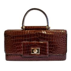 1940's HERMES crocodile top handle bag with geometric hardware | From a collection of rare vintage handbags and purses at http://www.1stdibs.com/fashion/accessories/handbags-purses/