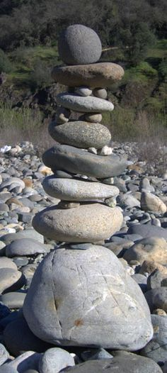 Cairn; travelers would add stones to the piles as they passed by as markers or memorials.