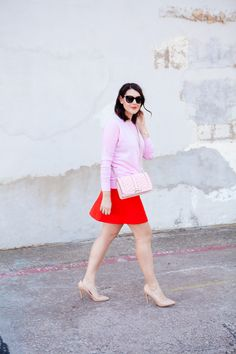 pink top with red skirt and nude pumps