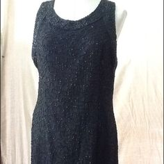 Beautiful vintage little black beaded dress True vintage! This Laurence Kazar sheath dress is in beautiful condition and beaded all over. The back has an 8 inch slit on the bottom. No missing beads that I could find. It is absolutely gorgeous. The lining is 100% polyester and shell is 100% silk. Size XXL. Laurence Kazar Dresses