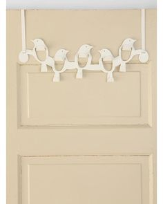 Add storage to your space with over-the-door hooks. Get it here: http://www.bhg.com/shop/urban-outfitters-exclusives-over-the-door-flock-of-birds-hook-p5018f46782a797dc894be22b.html