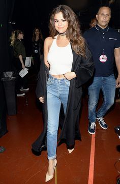 Selena Gomez wears Fallon Armure Watch Strap Leather Wrap Chocker, Silence + Noise top and Re/Done Relaxed Straight Jeans