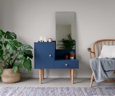 A genuine mid century dressing table with a tilting, removable mirror, cupboard & drawer storage. It has been carefully hand painted in navy with solid wood legs and handles, finished with soft wax. The drawer has been lined with marbled paper. A truly unique piece that will create a focal point in your home.  D I M E N S I O N S Approximately 73cm wide x 42cm deep x 70.5cm tall (131cm tall including the mirror) The depth of 42cm is for the unit only, please take into account the 2 mirror...